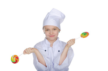 Young chef with colorful candy