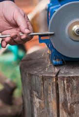 sharpening  of iron by abrasive disk machine