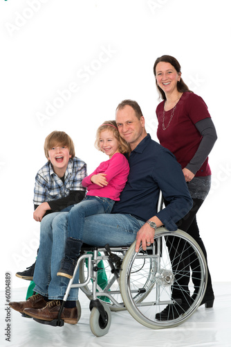 man in wheelchair with family