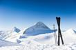 Leinwandbild Motiv Skis in high mountains at sunny day
