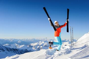 Jumping girl in fresh snow powder - winter fun