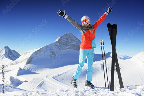 Jumping girl in fresh snow powder - winter fun