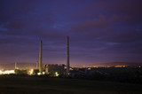 industrial landscape with towers at night