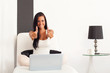 Woman with laptop and thumbs up