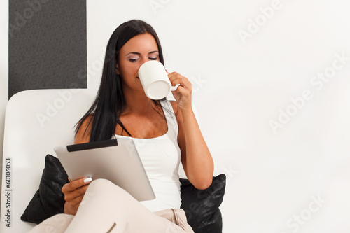 Woman with a digital tablet at home