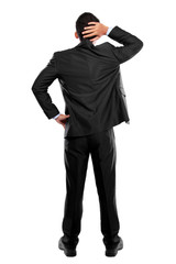 Back pose of a business person thinking