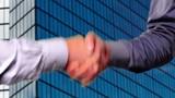 Handshake: Two businessmen shaking hands