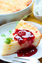 piece of cheesecake with raspberry jam