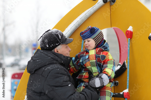 Grandfather with grandson at playground