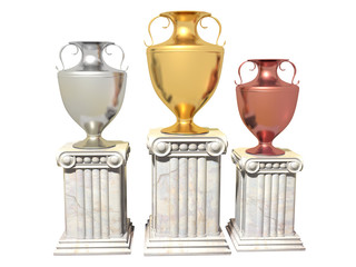 Gold, silver and bronze cups on a marble pedestal