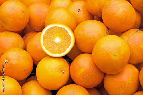 canvas print picture Ripe oranges for sale on a market