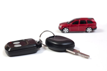Car keys with red car in background