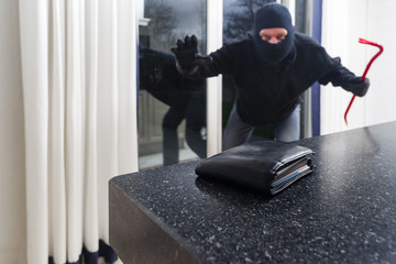 Burglar with a crowbar