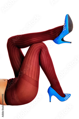 Legs in burgundy pantyhose.