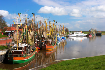 Crabber boats and ship in Greetsiel harbor - northern of Germany