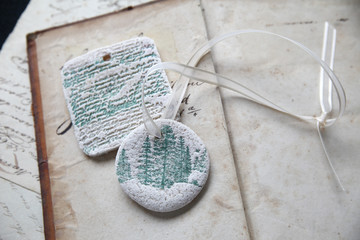 vintage pages with handmade dough ornaments