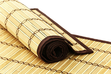 Rolled bamboo mat on a bamboo mat