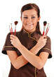 Professional beautician holding brushes