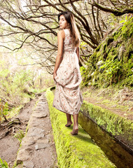 young woman walk barefoot on forest
