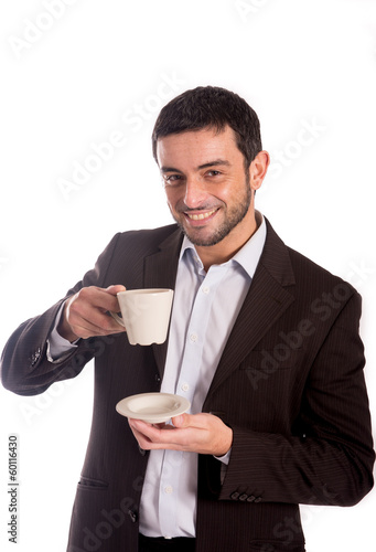 man drinking coffee in a suit