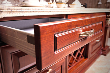 wooden cupboard with opened empty drawer