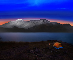 camping tent with rock and snow mountain scene