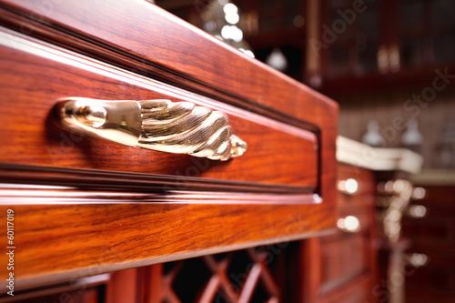 wooden cupboard with opened empty drawer - 60117019