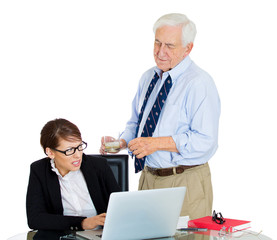 Portrait of old man harassing young woman at workplace