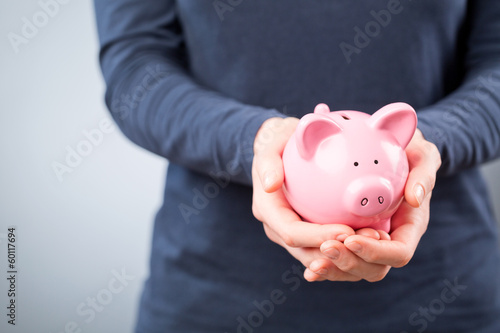 Care for Savings - Woman with a Piggy Bank
