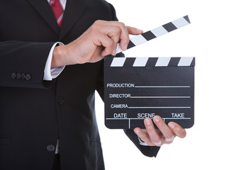Close-up Of Man Holding Clapperboard