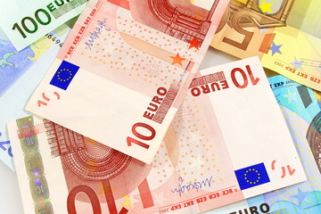Macro details of 10 Euro note over others as background