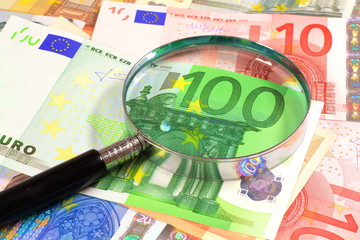 Magnifying glass over Euros. Perfect for financial or commerce