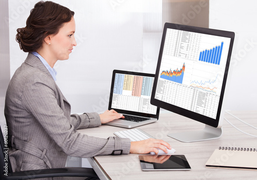 Young Businesswoman Analyzing Graph On Computer