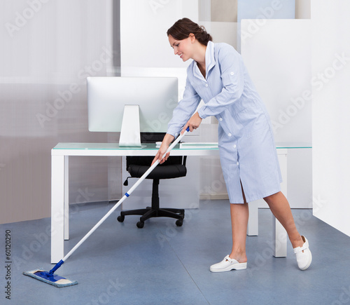 Maid Cleaning Floor In Office