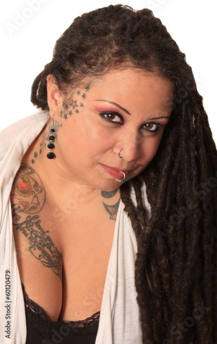 Tattooed woman  with piercings and dreadlocks