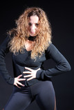 Curly hair woman dance and move at the studio