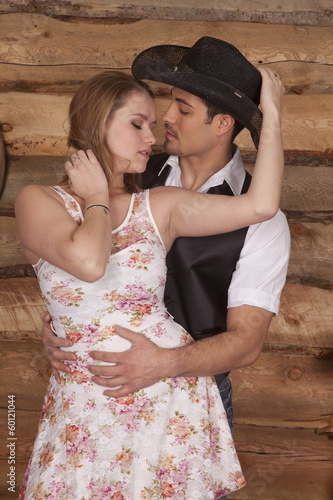 Couple western faces together hand on hat