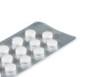 white pills packed in blister