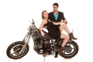 woman sit motorcycle leg up man behind