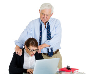 Elderly senior businessman harassing colleague at work