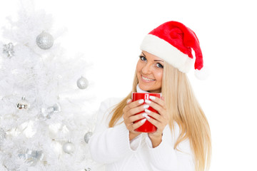 Young woman in Santa Claus cap.