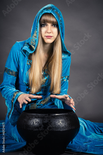 witch with cauldron isolated on gray background