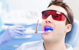 Dentist ultraviolet light equipment poster
