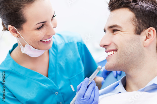 Female dentist with male patient