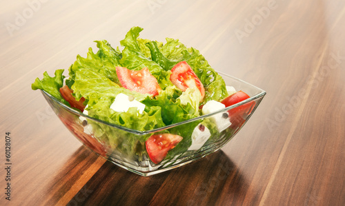 Green salat in a bowl on desk