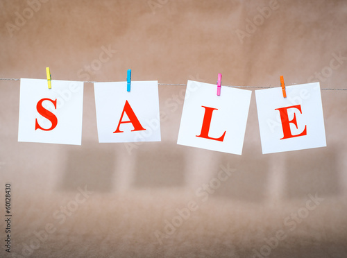 word sale on slips of paper