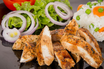 Grilled chicken meat with vegetable salad