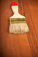 paint brush on wooden background closeup