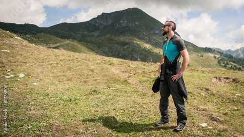 Sportsman portrait outdoor in the mountains. Alps, Italy.