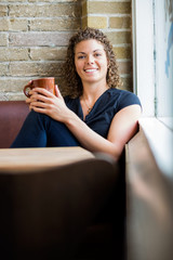 Happy Woman With Coffee Mug In Cafe